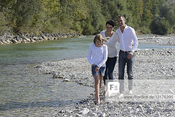 Family walking at the river Isar  Upper Bavaria  Germany