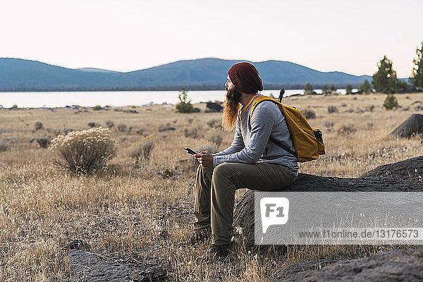 USA  North California  bearded young man having a break on a hiking trip near Lassen Volcanic National Park