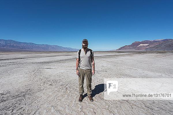 USA  California  Death Valley  man standing in desert