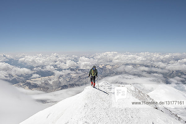 Russia  Upper Baksan Valley  Caucasus  Mountaineer ascending Mount Elbrus