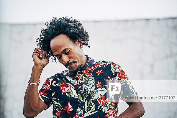 Portrait of dancing man wearing shirt with floral design