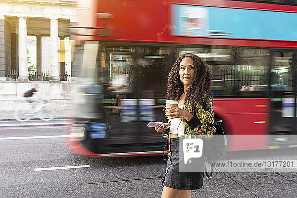 UK  London  young woman on the move in the city