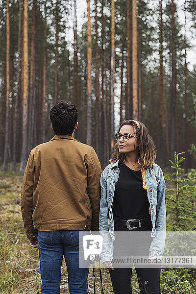 Finland  Lapland  man with camera and woman standing in rural landscape