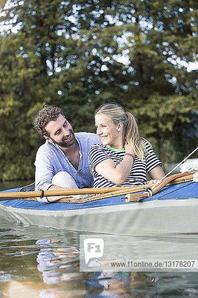 Happy young couple enjoying a canoe trip