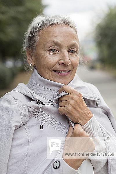 Portrait of smiling senior woman wearing a coat