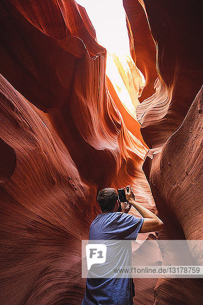 USA  Arizona  Lower Antilope Canyon  tourist photographing