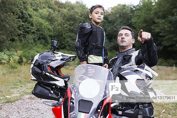 Father and son having a break during a motorbike trip