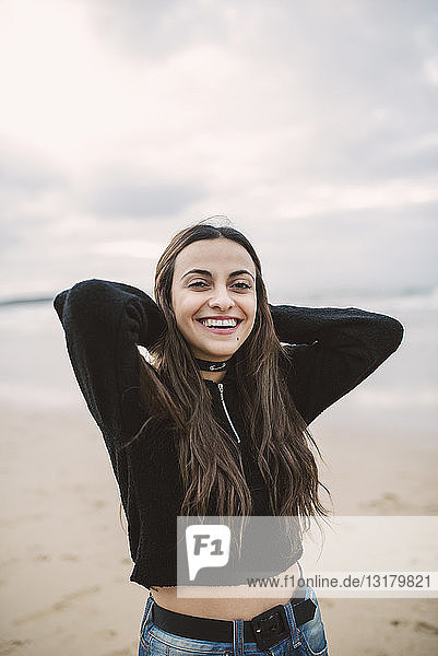 Portrait of happy young woman on the beach