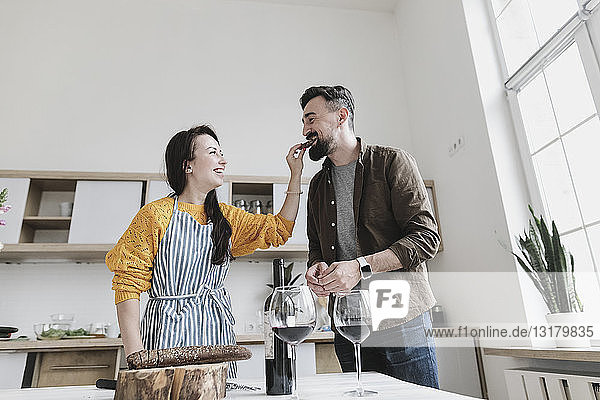 Couple in love having fun together in the kitchen
