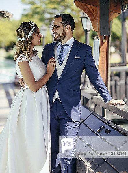 Bridal couple enjoying their wedding day in a park