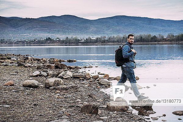 Russia  Amur Oblast  man with backpack at Zeya River