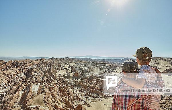 Chile  Valle de la Luna  San Pedro de Atacama  two boys looking at desert