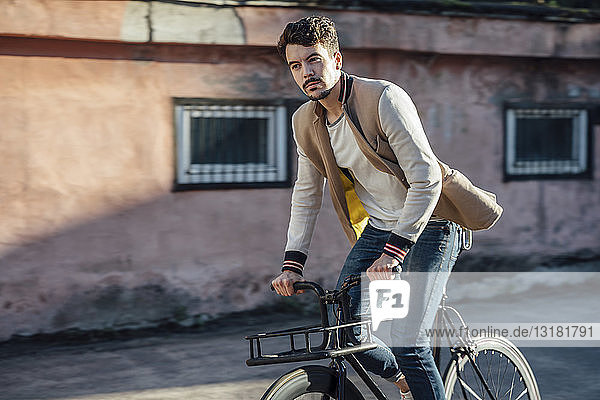 Young man riding commuter fixie bike in the city