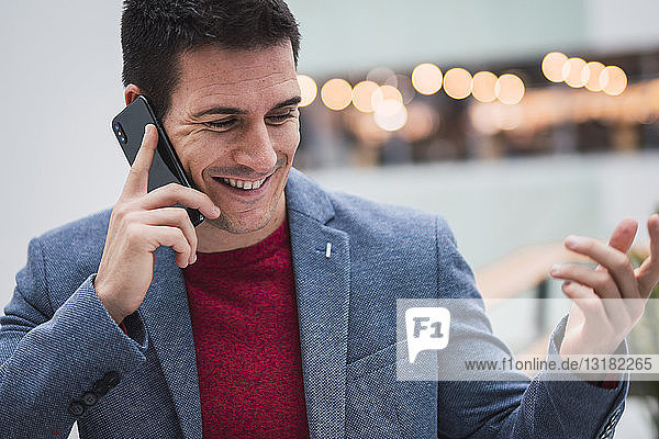 Businessman in lobby of a modern building  using smartphone