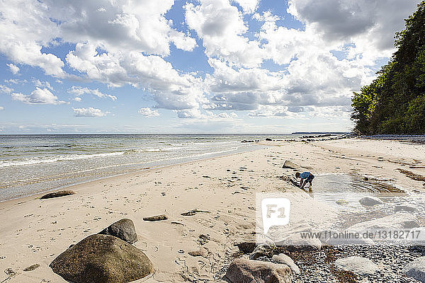 Boy playing at the beach