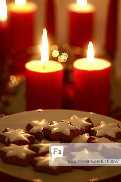 Plate of cinnamon stars at candle light