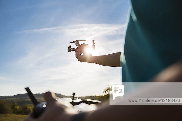 Boy flying a drone outdoors