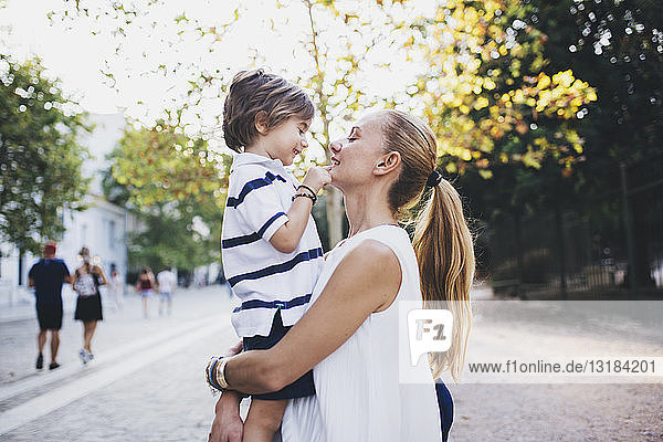 Mother standing in the city  holding her son