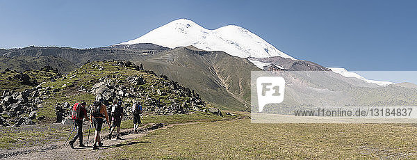 Russia  Caucasus  Mountaineers hiking in Upper Baksan Valley