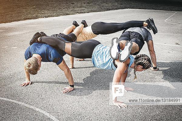 People during workout  pushups