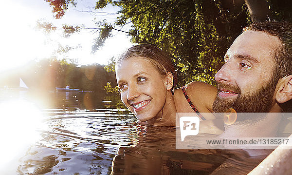 Happy young couple in a lake