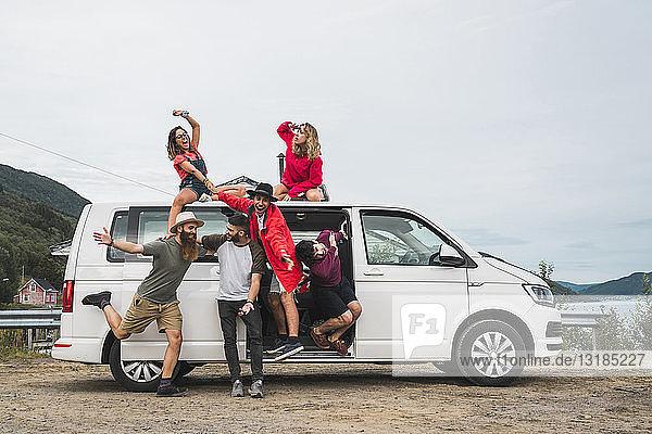 Traveling friends having fun taking a break on their journey through Norwegian Lapland