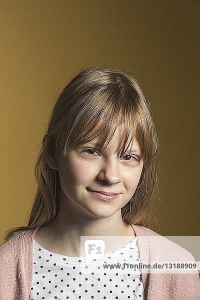 Portrait confident tween girl