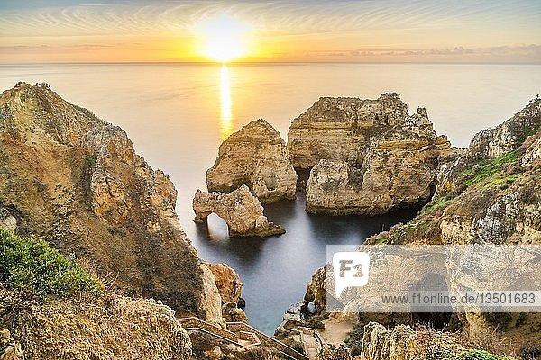 Cliffs and arches in Ponta da Piedade at sunrise  Lagos  Algarve  Portugal  Europe