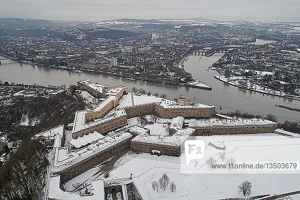 The snow-covered Ehrenbreitstein fortress in Koblenz high above the Deutsches Eck at the confluence of the Rhine and Moselle rivers  drone shot  Koblenz  Rhineland-Palatinate  Germany  Europe