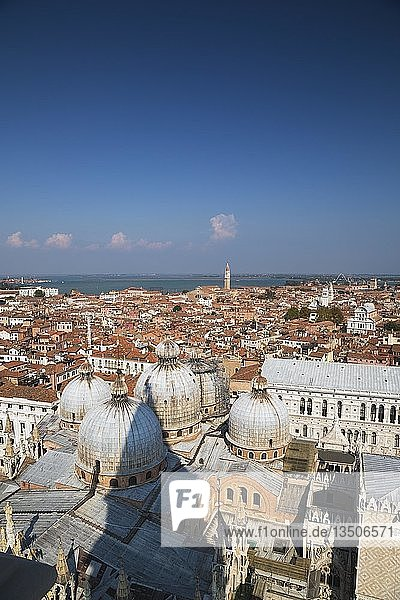 St Mark's Basilica with Romanesque domes and ornate Gothic and Byzantine architectural details plus the Doge's Palace built in the Venetian Gothic architectural style  St Mark's Square  San Marco  Venice  Veneto  Italy  Europe