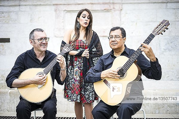 Fado band performing traditional portuguese music on the square of Alfama  Lisbon  Portugal  Europe