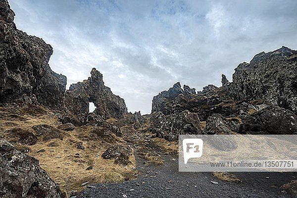 Rock arch  volcanic rock on the beach of Djúpalónssandur  Snæfellsnes peninsula  West Iceland  Iceland  Europe