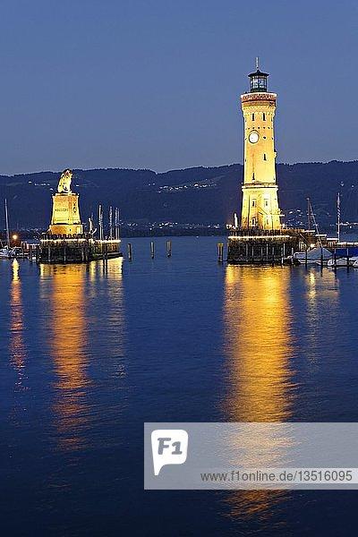 Illuminated Bavarian lion and the lighthouse at dusk  Lindau at Lake Constance  Swabia  Bavaria  Germany  Europe