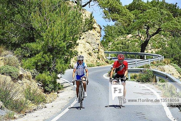 Two racing cyclists on a winding road  Dikti Mountains  near Kroustas  Crete  Greece  Europe