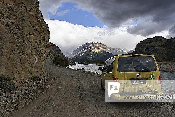Yellow travel minibus on road to Lago del Desierto at Rio de las Vueltas  near El Chalten  Patagonia  Argentina  South America