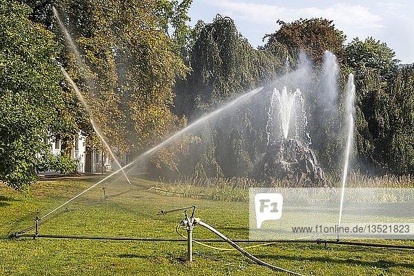 Irrigation of the green areas in the spa garden,  Lichtentaler Allee,  Baden-Baden,  Baden-Württemberg,  Germany,  Europe