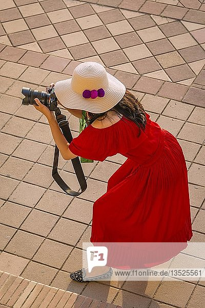 Woman with sun hat and red dress photographed,  Sevilla,  Spain,  Europe