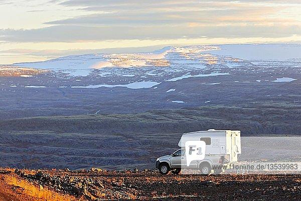 Camper Van parked in volcanic landscape  Westfjörds  Iceland  Europe