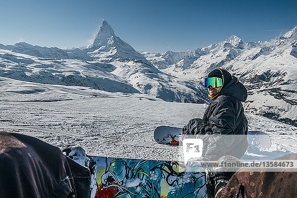 Personal perspective snowboarders on snowy ski slope  Zermatt  Switzerland