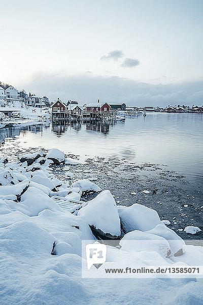 Scenic snowy view waterfront fishing village  Reine  Lofoten Islands  Norway