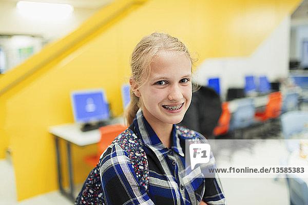 Portrait confident junior high girl student with braces Portrait confident junior high girl student with braces