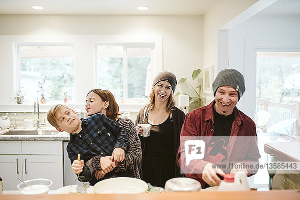 Portrait happy  playful family baking in kitchen