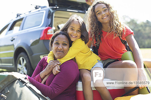 Portrait happy mother and daughters camping