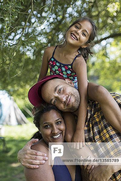 Portrait happy family in backyard