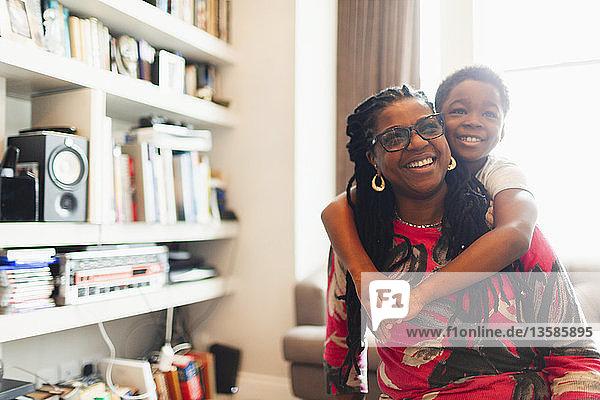 Happy grandmother and grandson hugging