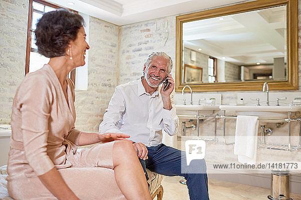 Mature couple in hotel bathroom
