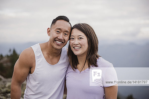 Portrait happy couple hiking