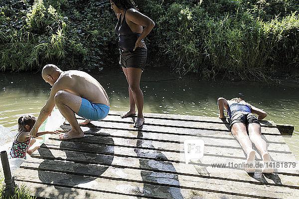 Family on riverside dock