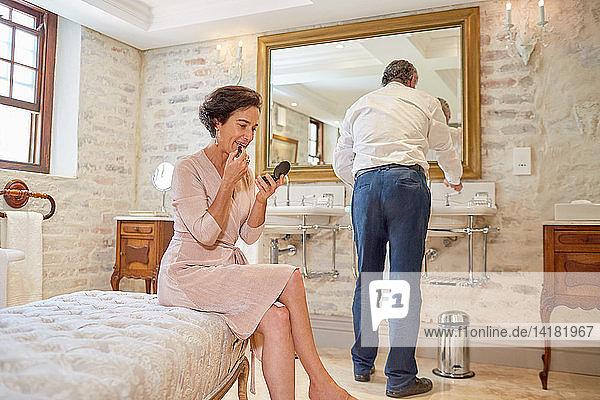 Couple preparing in hotel bathroom