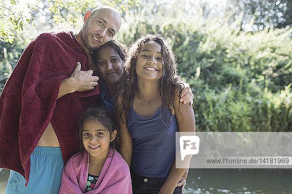 Portrait happy family at sunny riverside